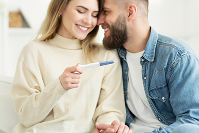 Happy couple looking at a pregnancy test