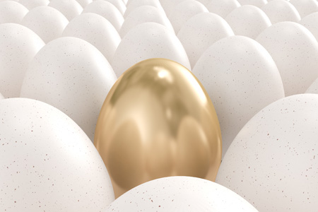 Golden egg sitting amoung ordinary white eggs
